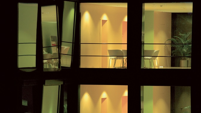 View through the windows into the Central Institute Building of the University of St.Gallen (HSG) by night